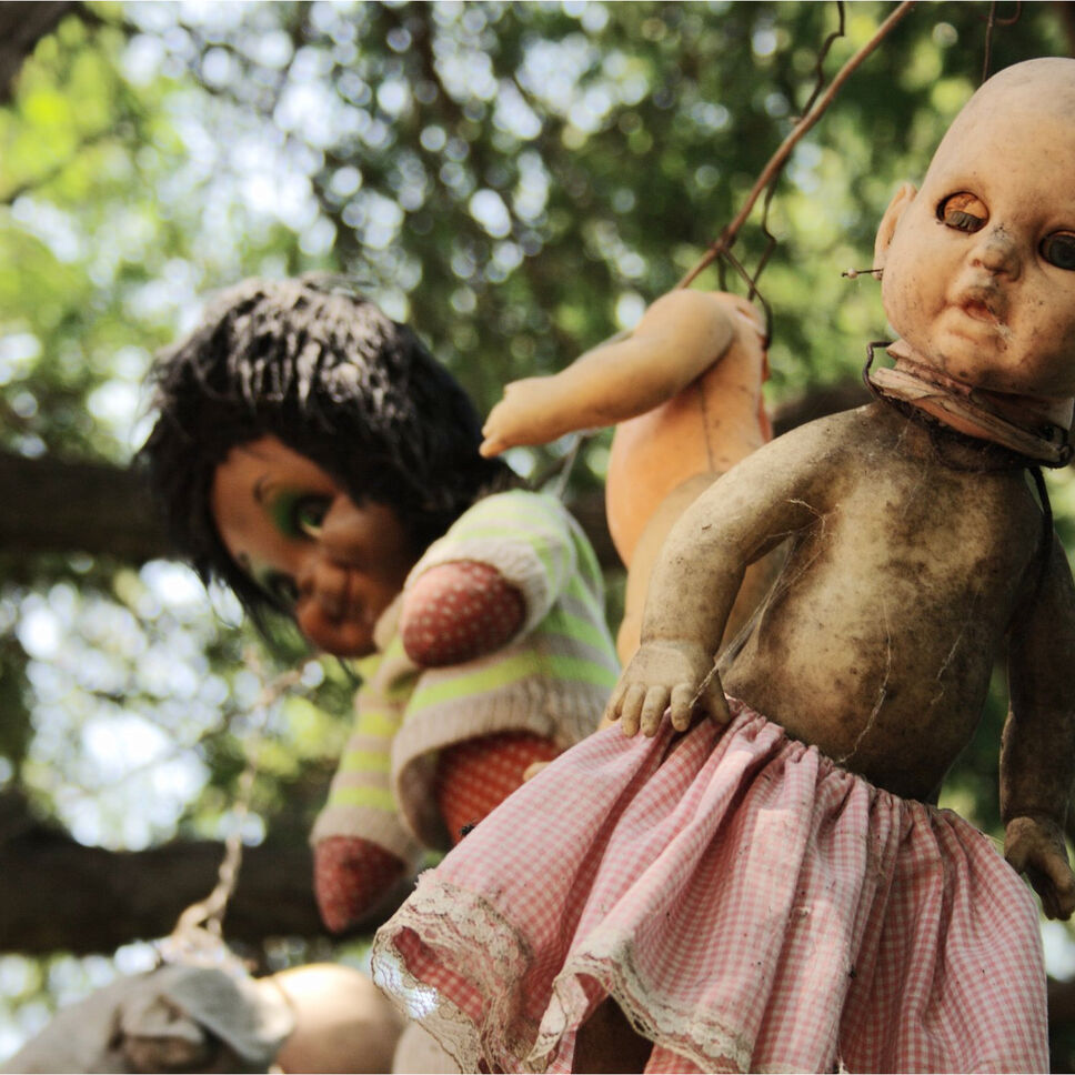 Island of the Dolls, Xochimilco, Mexico. The creepy factor with this one is pretty high. In the 1950s, a man named Julian, who was the caretaker of the island, sensed the spirit of a young girl who had drowned was also present on the island. In an attempt to calm her spirit, he bought hundreds of dolls and hung them from the trees in an attempt to make her happy. Some say he was driven mad by the thought that he could not save her. Later, Julian was found drowned in the same spot the girl had died. Today, residents of the island say many spirits haunt the dolls.