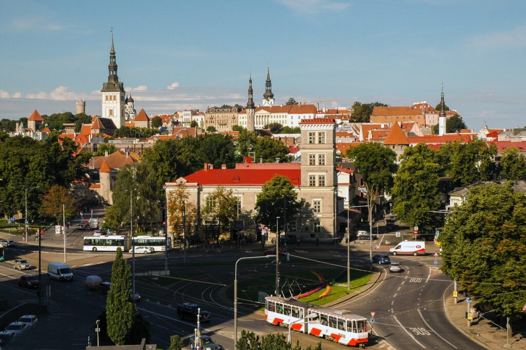 an aerial view of a large intersection in Tallinn with the old town in the background